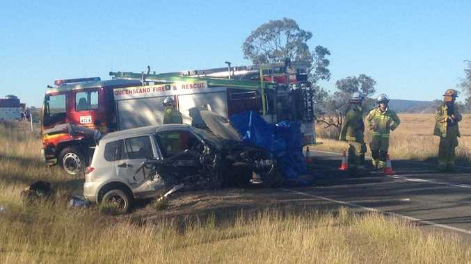 Emergency services attend a crash near Gayndah in which a Toowoomba man died yesterday. Photo: Sue Harris