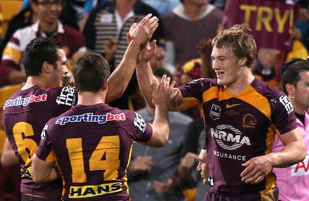 Aaron Whitchurch of the Broncos celebrates scoring a try during the round 17 NRL match between the Brisbane Broncos and the Cronulla Sharks at Suncorp Stadium on June 29, 2012 in Brisbane, Australia.