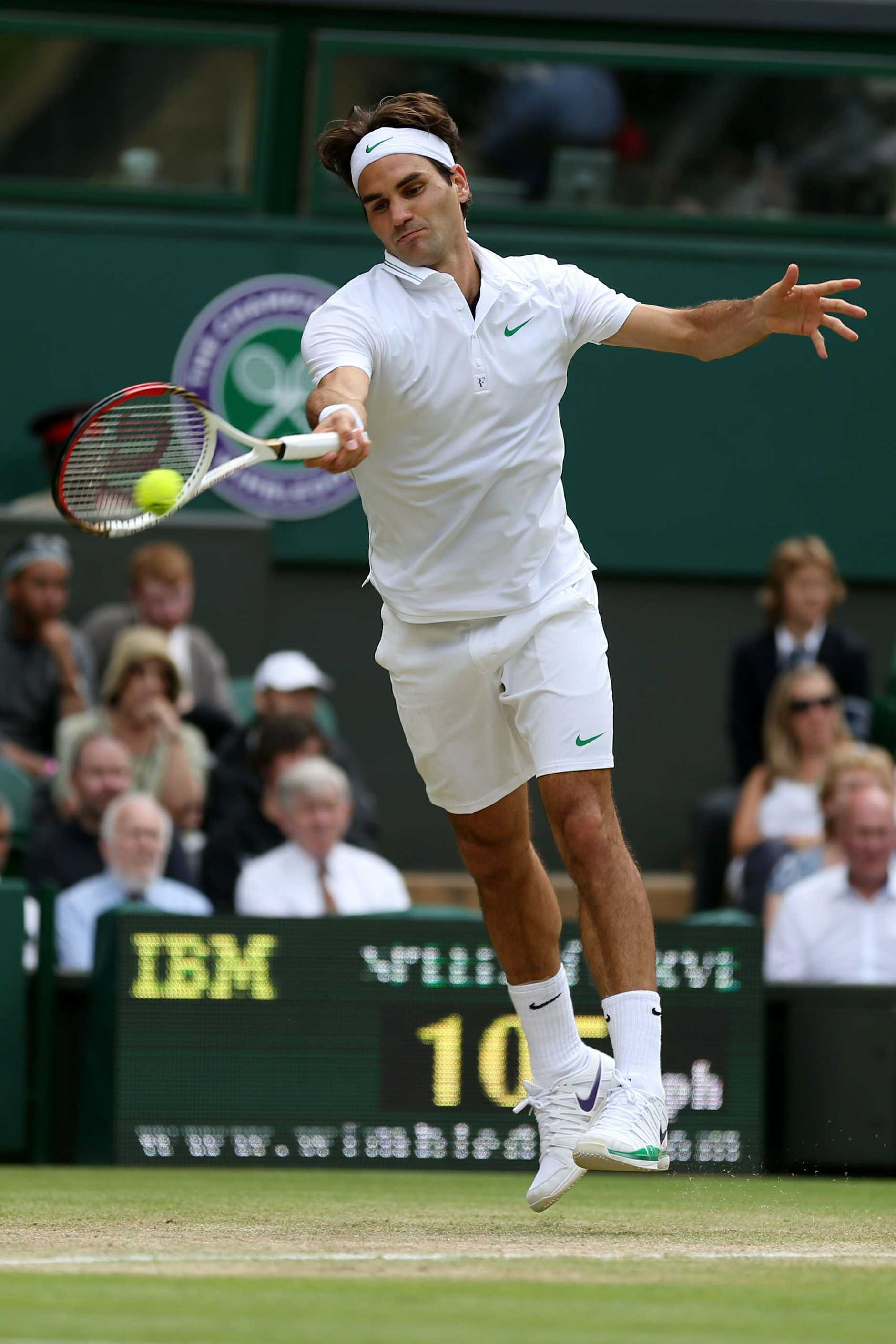 Roger Federer in action during his Gentlemen's Singles quarter final match against Mikhail Youzhny on day nine of the Wimbledon Lawn Tennis Championships.