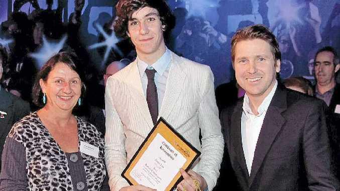 James Lea from Trinity College receives his Kids in Community Award from Margie Heffernan and Chris Radburn.