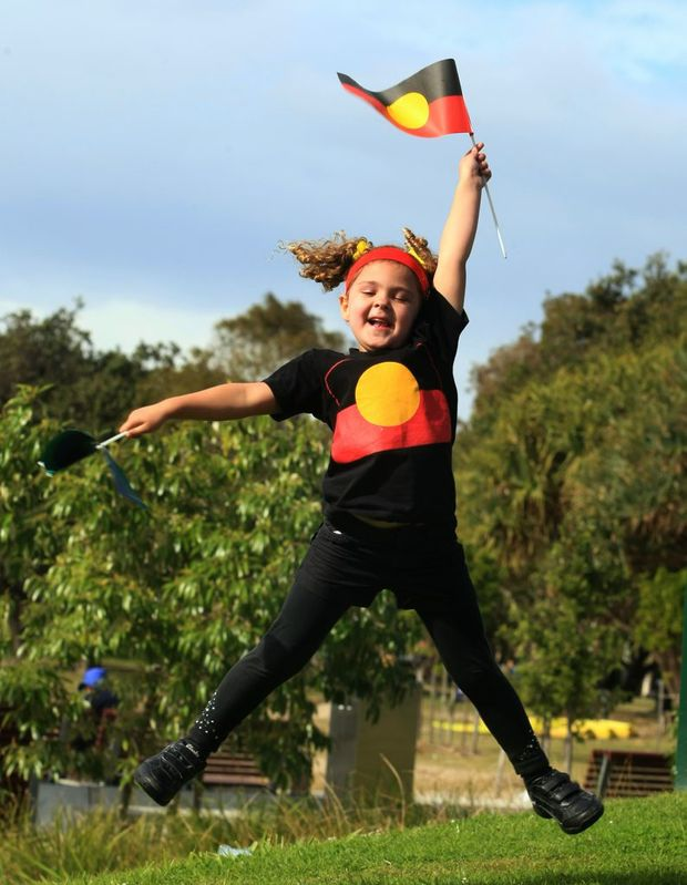 Mikaela Mulheran gets into the spirit of NAIDOC Week at Jack Evens Boat Harbour.