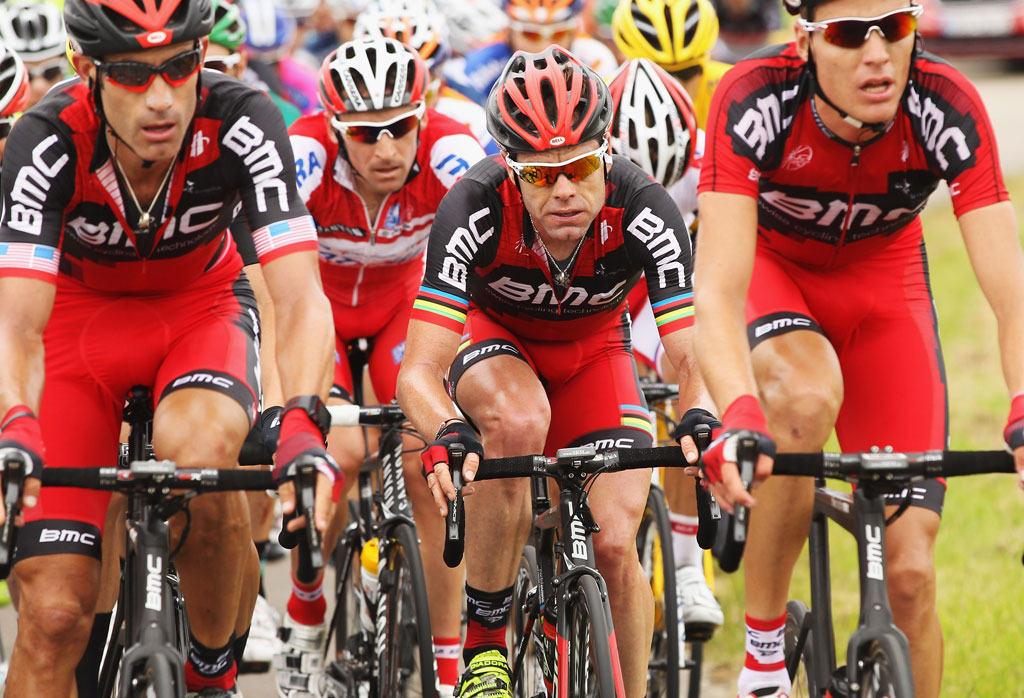 2011 Tour de France winner Cadel Evans (pictured centre) punctured three times in less than a kilometre.
