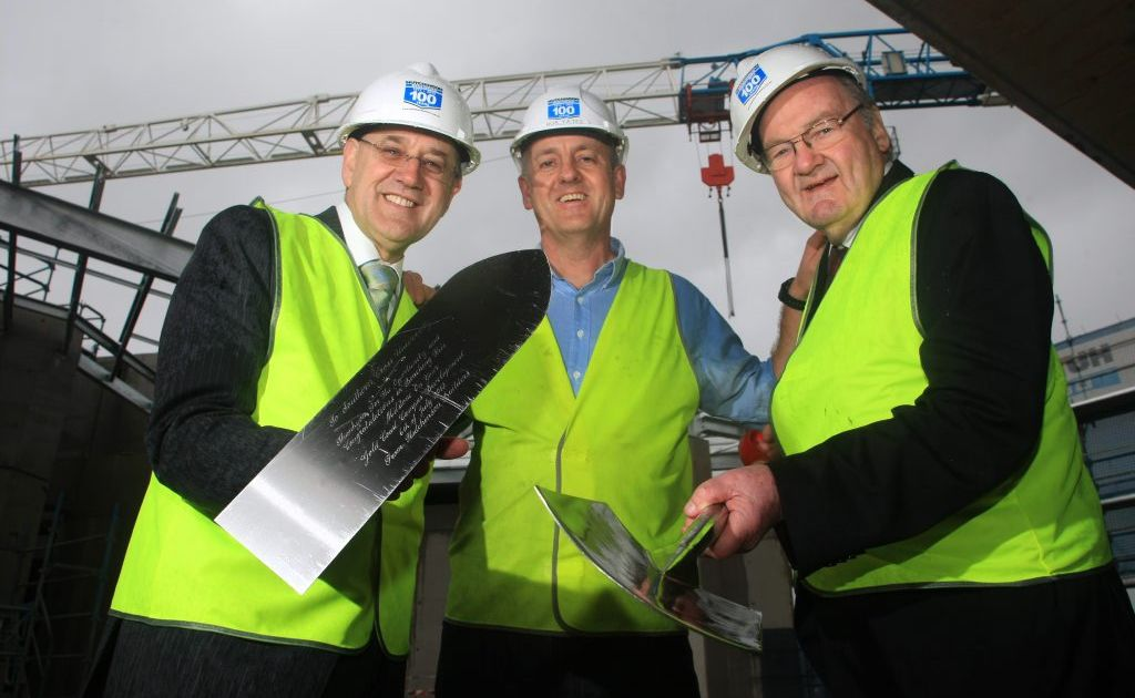 Vice chancellor Peter Lee, Rob Yates of Hutchinson Builders and SCU chancellor John Dowd at a topping out ceremony to celebration a construction milestone at SCU Gold Coast-Tweed campus.