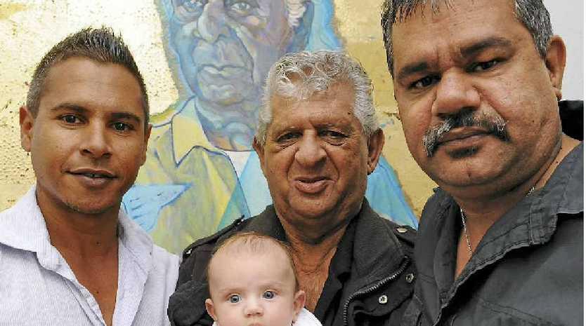 Everett Johnson, Mervyn Johnson, Tokoko Watson and Melvin Johnson admire the painting of their ancestor George Johnson hanging at the Bundaberg Regional Art Gallery during NAIDOC Week.