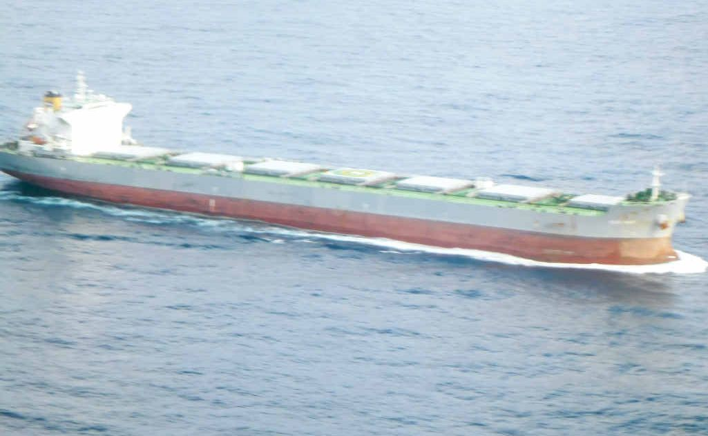 The bulk carrier Blue Wave remains in the ocean off Evans Head while the search for the crewman continues.