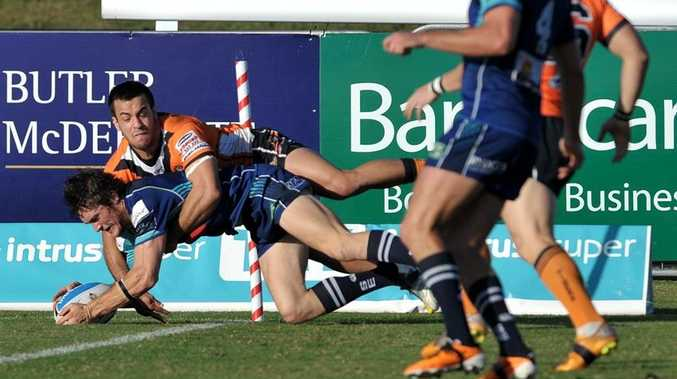 Sunshine Coast Sea Eagles' Dale Middleton dives over for a try in match against Easts.