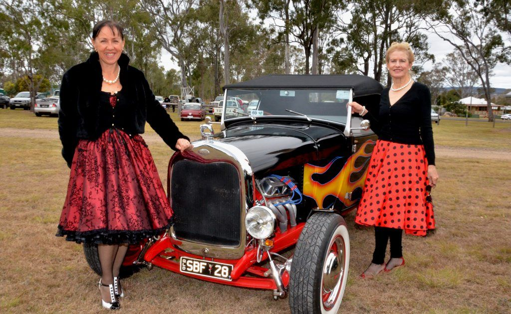 WHERE IS THE DANCING? Chris Hone and Beate Newing show off their dancing shoes and the 28 Ford Roadster. Photo: Contributed