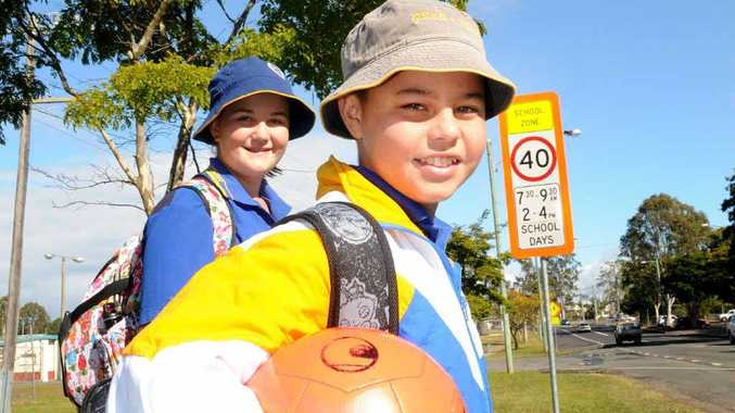 Eily King and Izaak Webb from Gympie South State School check out the new school zone signs.