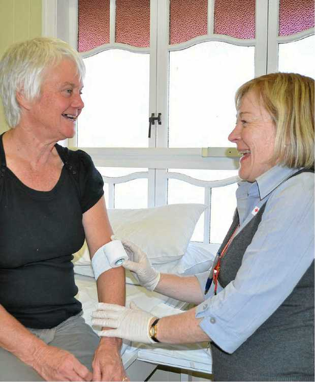 Maryvale's Julie McFetridge, with Red Cross nurse Anne-Marie Buckly, gives blood for her 181st time.