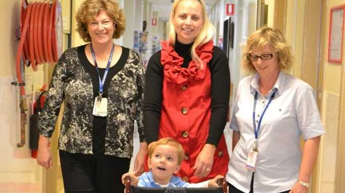 Walking a donated transit wheelchair through the Toowoomba Hospital Palliative Outreach Service are (from left) Jo Hiscock, Madonna Brennan, her son Oliver and Terri Cox.