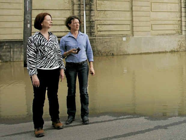 Prime Minister Julia Gillard with Capricornia MP Kirsten Livermore during the 2011 floods. Livermore has come out saying she'll continue to support Ms Gillard despite Simon Crean's call for a leadership spill today.