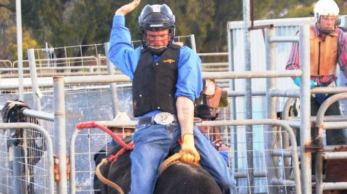 A rider hangs on to a bucking bull for a good cause.