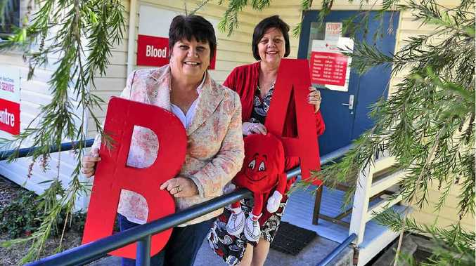 Councillor Maxine Brushe and Gladstone Region Mayor Gail Sellers donate at the Australian Red Cross Blood Service.