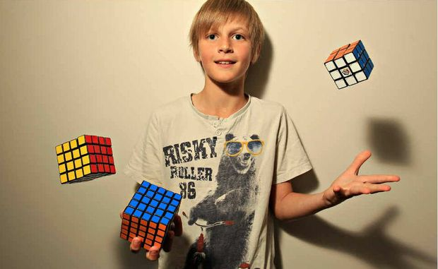 Juggling Rubik's Cubes is a snap for 10-year-old Ryan Smart, who can also solve the puzzle in under a minute.