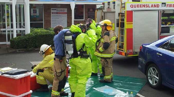Firefighters don chemical suits before entering Milne Bay pool.