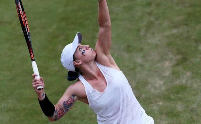 American Grand Slam doubles champion Bethanie Mattek-Sands shows off her tattoos at Wimbledon.