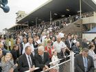 The large Grafton Cup crowd comes to the side of the members stand to watch the Grafton Cup winner return to scale. Photo Adam Hourigan / The Daily Examiner