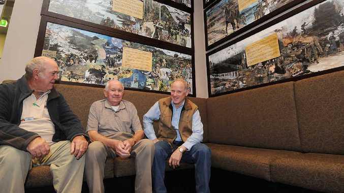 Vietnam Veterans Association's Allen Friske, Len Herron and Ken Williamson gather to discuss plans.