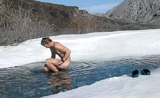 John Cantor braves the cold to bathe in Alaska.