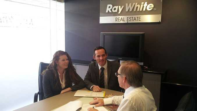 BOOMING OPPORTUNITIES: Chris and Tegan consult with a potential purchaser considering an investment property.