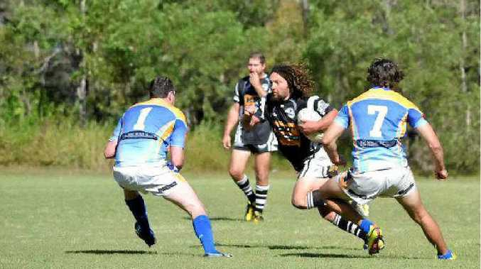 The Marlins' Sykes brothers (James No.1 and Jason No.7) round up a Magpie last time the clubs met in the local derby.