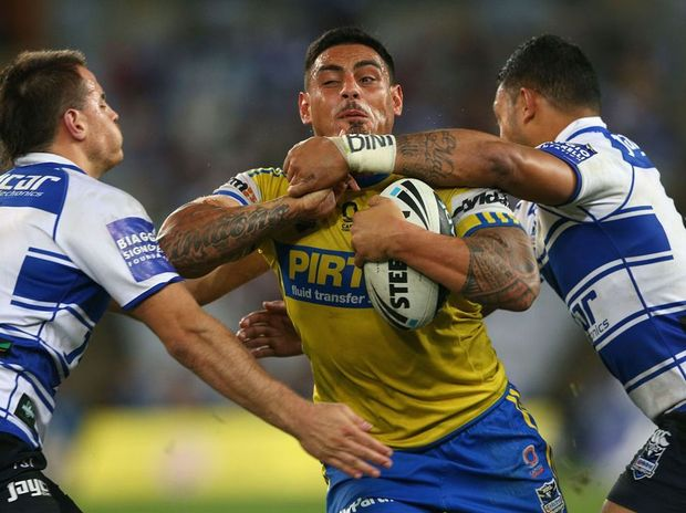 Reni Maitua of the Eels is tackled during the NRL Round 19 game between the Canterbury Bankstown Bulldogs and Parramatta Eels at ANZ Stadium