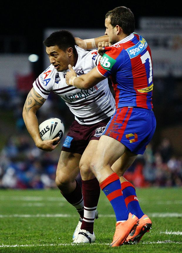 Dean Whare of the Sea Eagles is tackled by Tyrone Roberts of the Knights during the round 19 NRL match between the Newcastle Knights and the Manly Warringah Sea Eagle