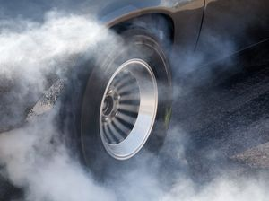 Off-duty cop catches woman doing burnout outside his home