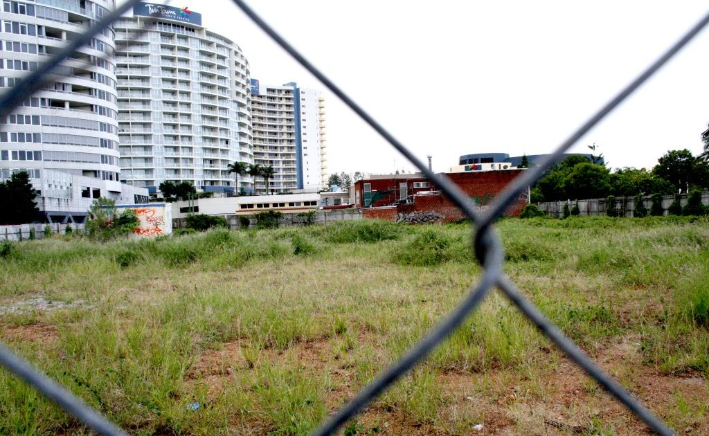 The overgrown vacant block on the corner of Bay and Wharf streets.