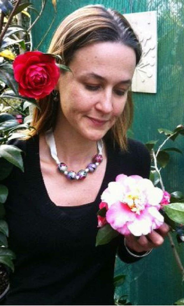 Chelsea van Rijn from Trevallan Lifestyle Centre with Camellia Japonicas.