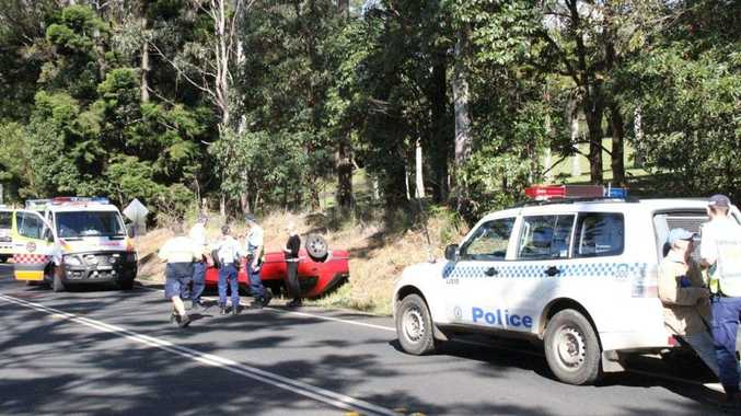 Emergency service workers clear the wreckage on the Bruxner Highway at Richmond Hill following a rollover early this afternoon.
