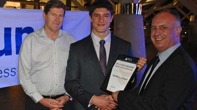 WINNER: APPEA Chief Executive David Byers (left) and Brunel Energy Director Paul Smith present Alex Dyball with his scholarship.