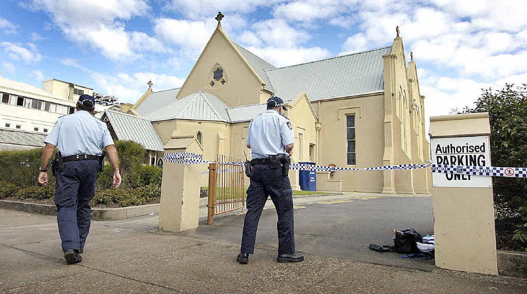 Police guard the crime scene where Wayne Ruks was bashed in 2008 – one of his killers is now free.