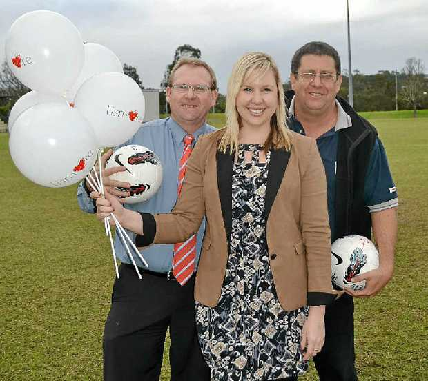 TOP SCORE: Steve Mackney from Football Far North Coast, Lismore City Centre manager Katie O'Rourke and Council events manager John Bancroft celebrate the coming of the Melbourne Hearts.