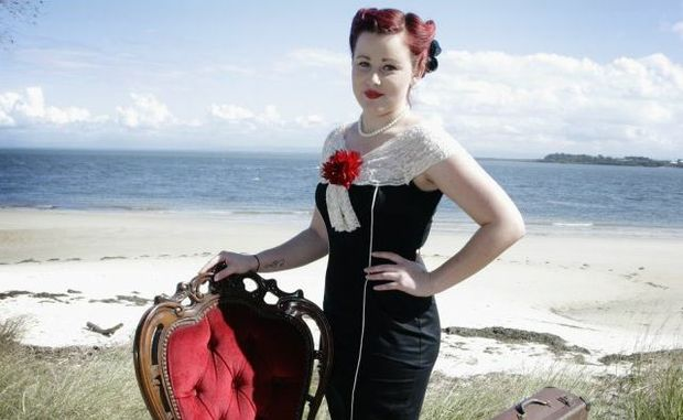 Pin Up Girl Jade Halley sits in style in front of the Bribie Island backdrop. Photo Vicki Wood / Caboolture News