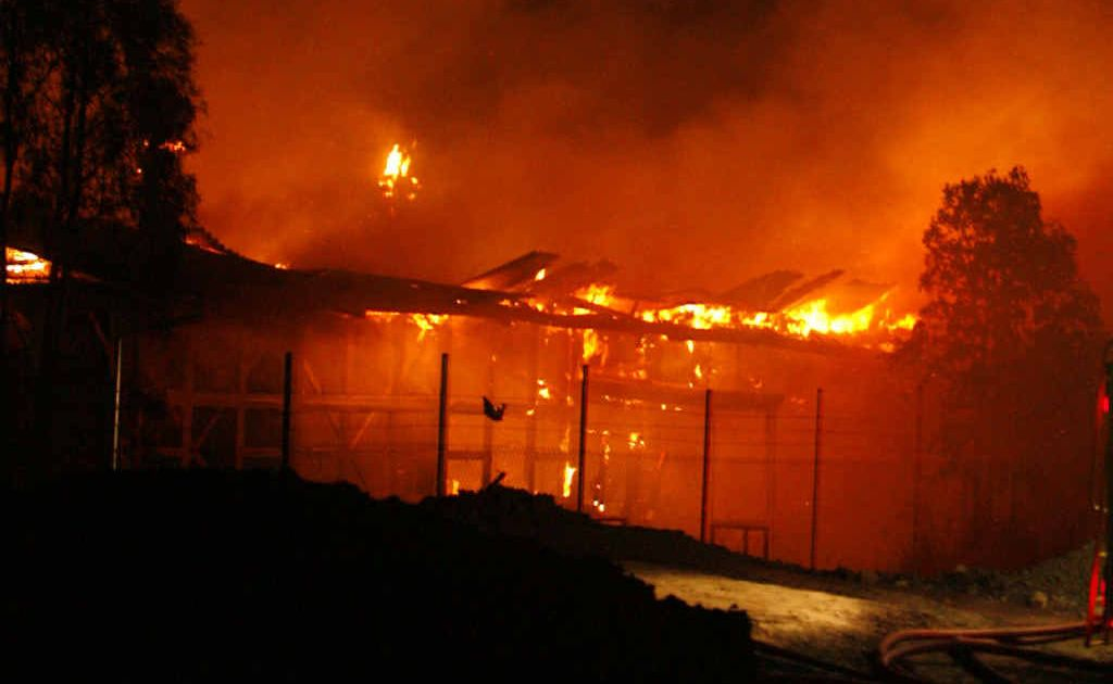 Fire engulfs buildings at the old North Ipswich Railway Workshops.