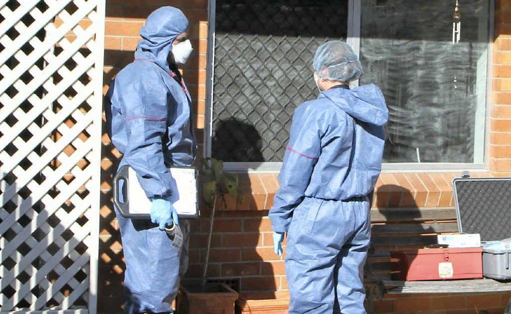 Forensic investigators inspect Mr Pullen's Valley St unit.
