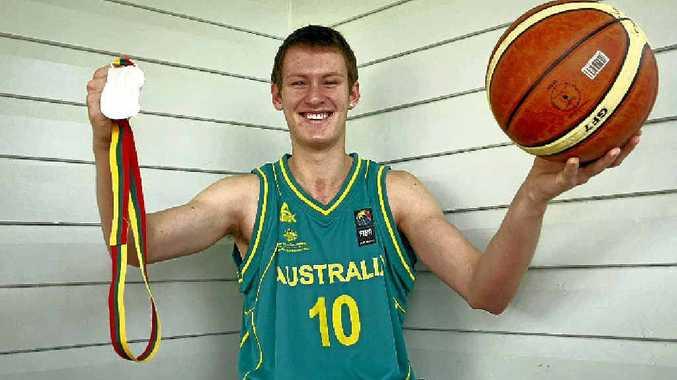 Australian representative basketballer Josh Derksen with his silver medal won at the under-17 world championships.