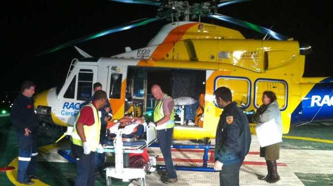 The teenage rugby player is unloaded from the RACQ CareFlight chopper at PA Hospital.
