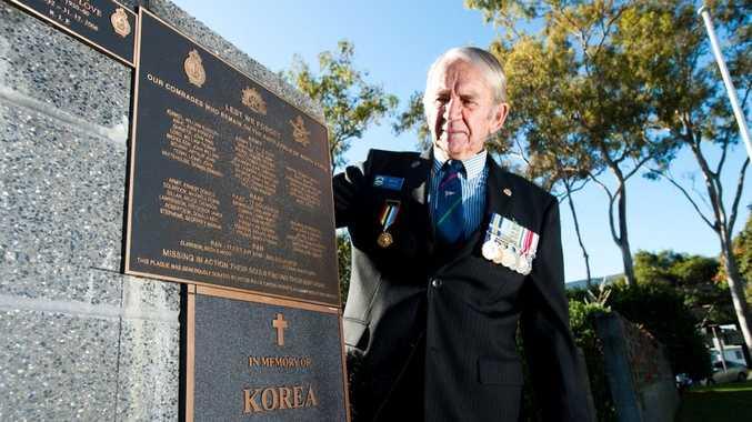RECOGNITION: Korean War veteran Max Gant unveils the new plaque at the Coffs Harbour cenotaph.