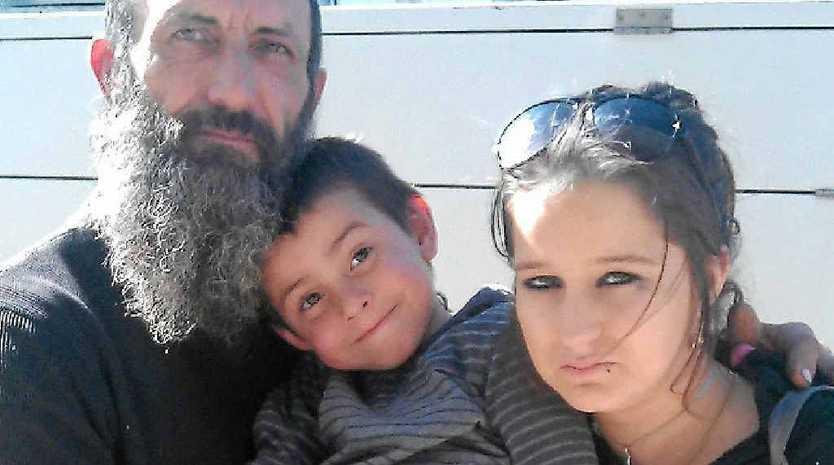 Ashley Huskisson with his children Kazaria, 4, and Alicia, 15.