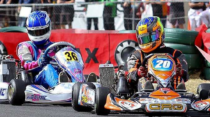 Toowoomba's Tyler Greenbury leads Daniel Rochford in the Rotax Light class during the Rotax Pro Tour karting series in Warwick at the weekend.