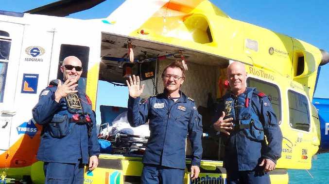 RACQ CQ rescue crewman Justin Craib, pilot Rick Kendall and air crewman Darren Bobin commemorate the service's 5000th mission.