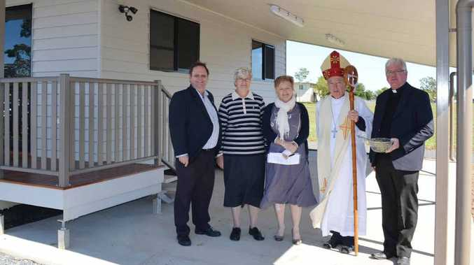 Mayor Peter Maguire, Sister Colleen, Diocesan director Dr Ricki Jeffery, Bishop Brian Heenan and Father Stephen Hanley attend to blessing the two new buildings.