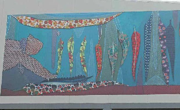 LOCAL ARTIST: Karla Dickens' koala mural on the new Woolworths supermarket in Goonellabah.
