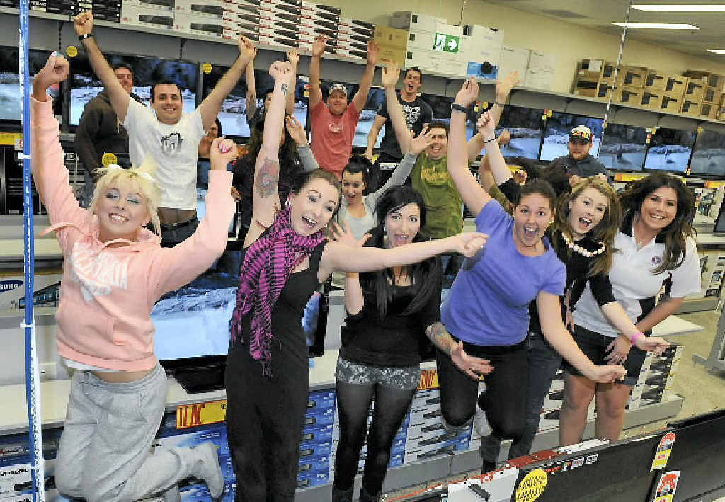 JB Hi-Fi staff are excited about opening their doors today.
