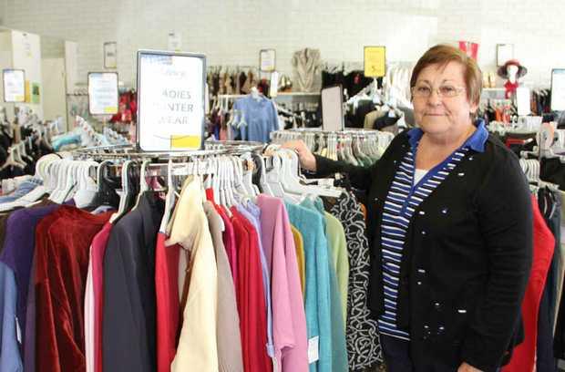 Emerald Lifeline volunteer Joan Lowery with a rack of warm coats.