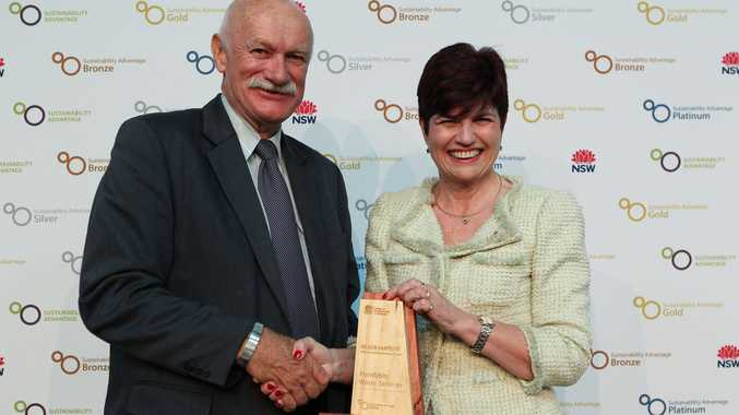 Handybin boss Harry Wilson receives the company award from NSW Environmental Minister Robyn Parker