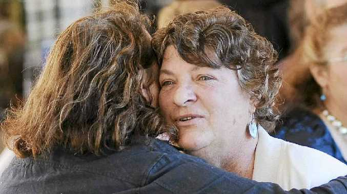 One of Ned Kelly's sisters, Margaret Simmons is comforted by a mourner following a service for Ned Kelly.