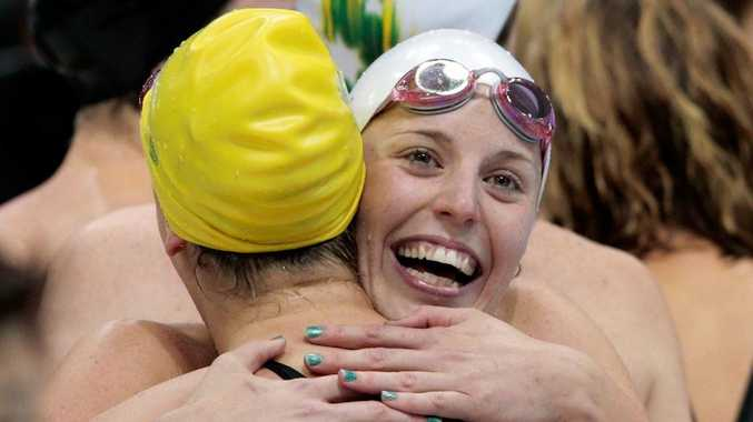 The Australian team celebrate winning the women's 400 metre freestyle relay final.